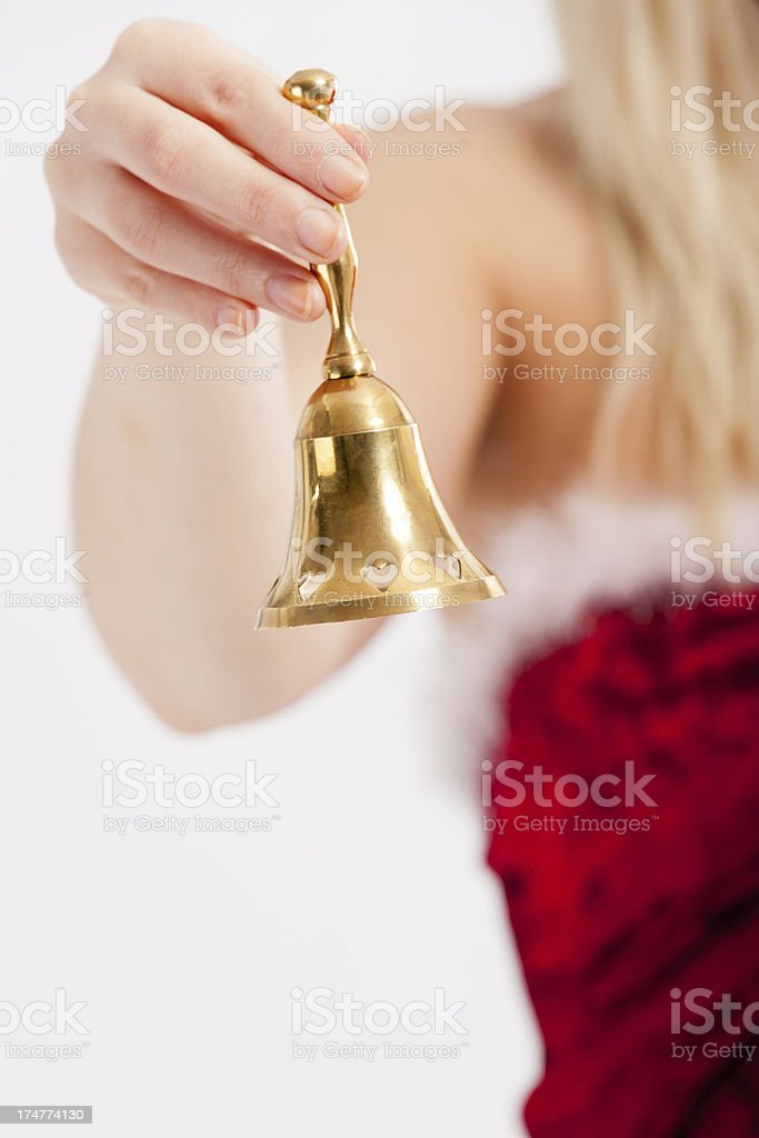 Woman in Christmas dress ringing bell stock photo