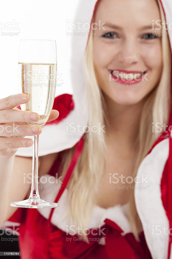 Woman in Christmas dress with champagne stock photo