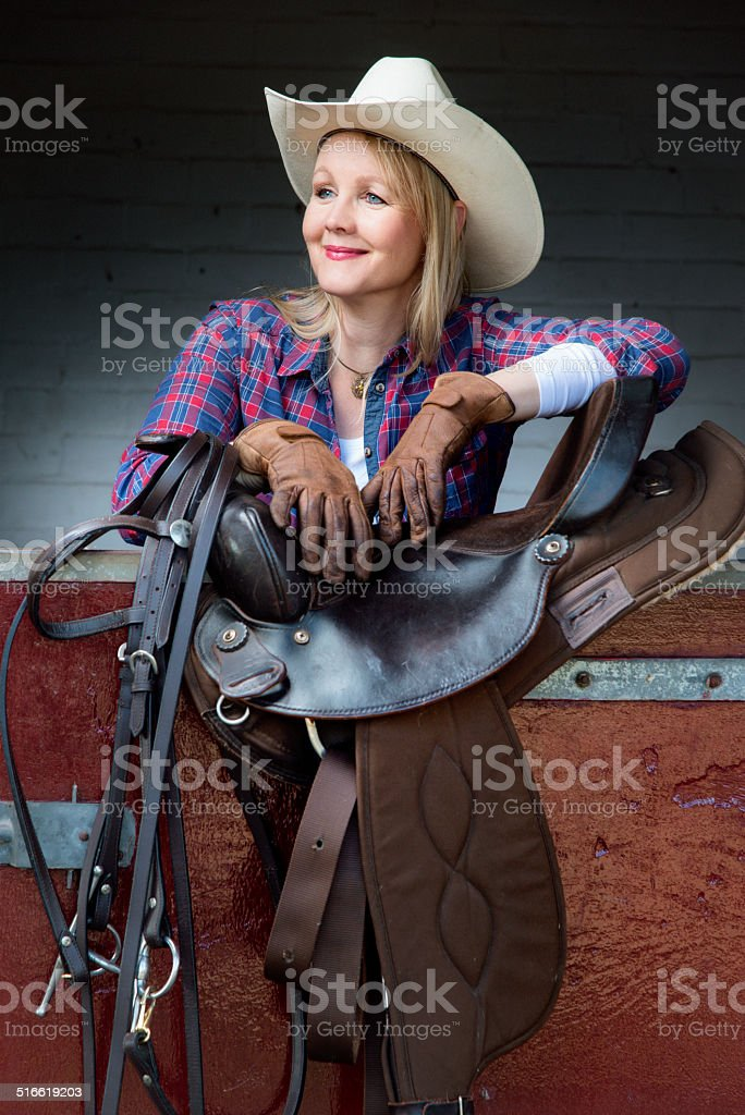 Woman in classic country & western horse ridding tenue stock photo