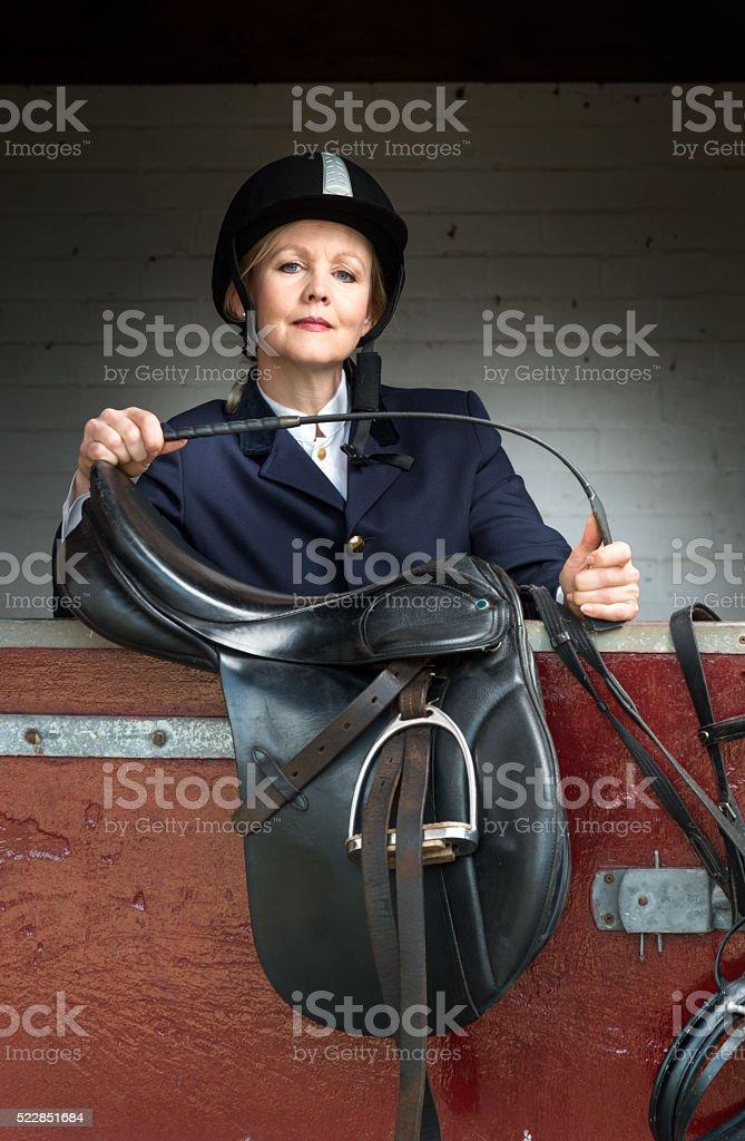 Woman in classic horse ridding tenue ,Equestrian sport - dressage stock photo