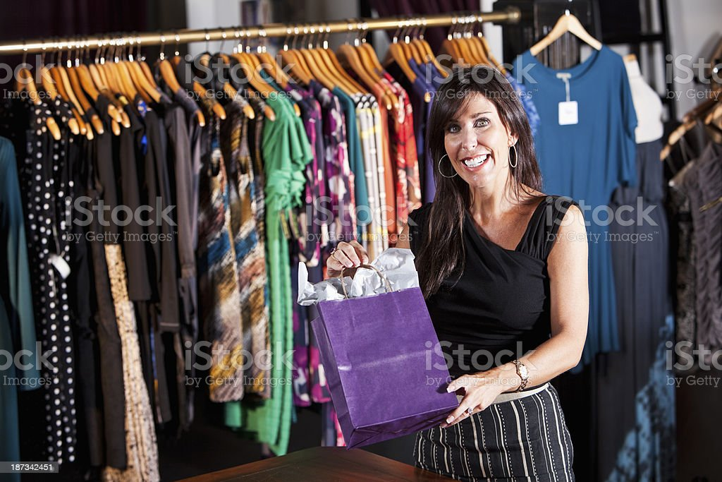 Woman in clothing store stock photo