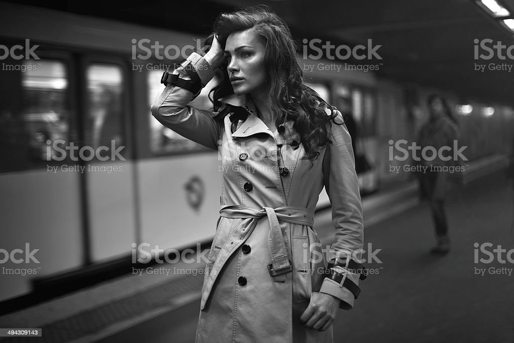 Woman in coat waiting for someone stock photo