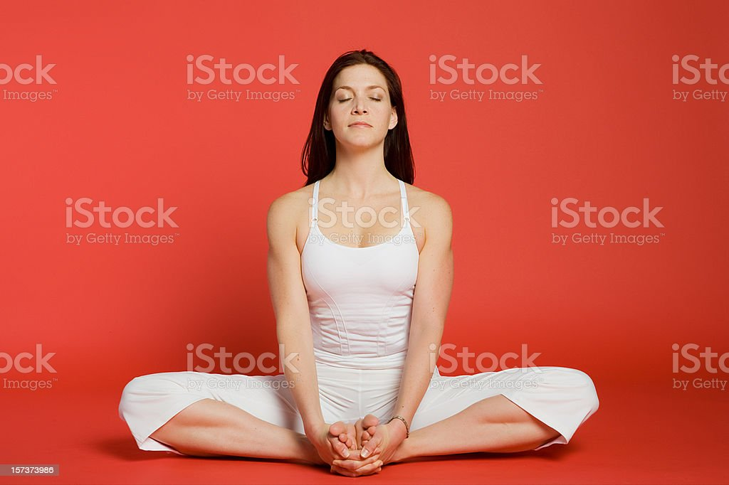 Woman in Cobbler Pose royalty-free stock photo