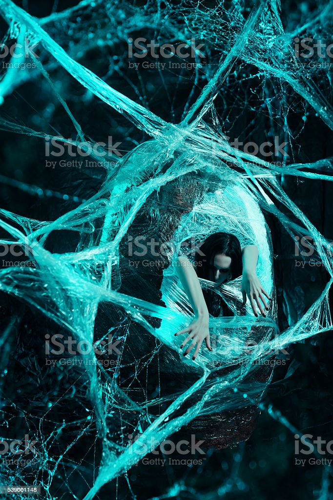 Woman in cocoon stock photo