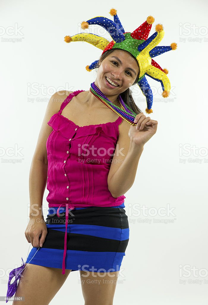 Woman in colorful Mardi Gras hat and beads smiling 2 stock photo