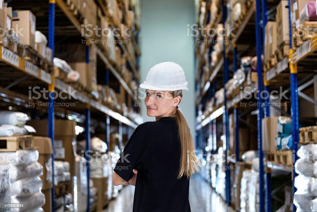 Woman in corridor of warehouse stock photo