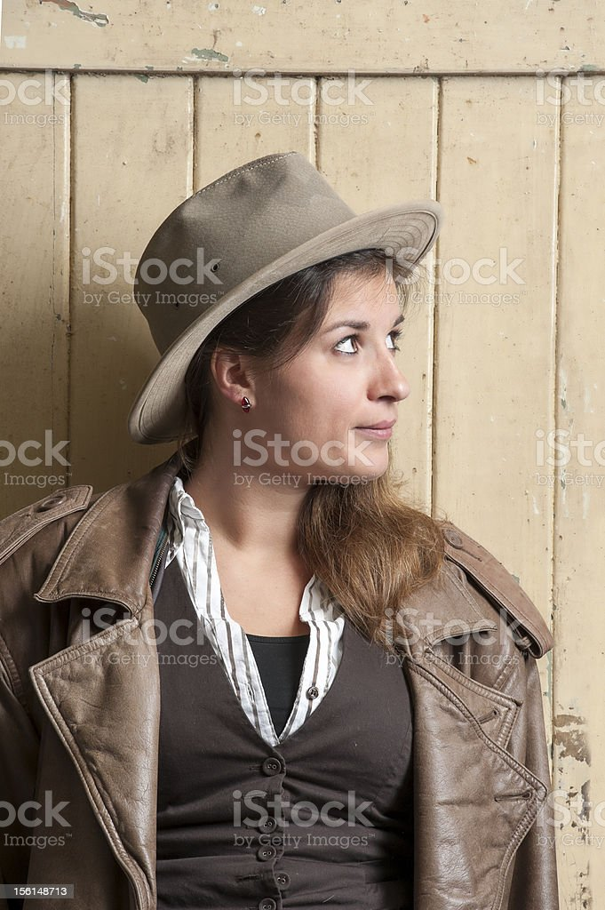 woman in cowboy coat and hat royalty-free stock photo