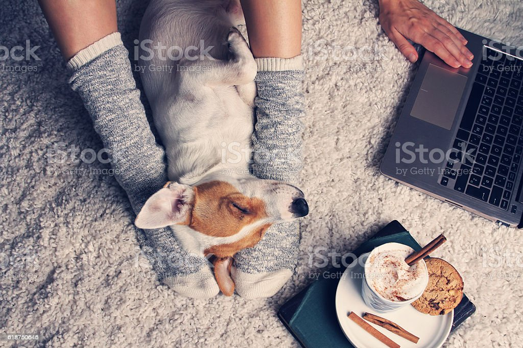 Woman in cozy home wear relaxing at home stock photo