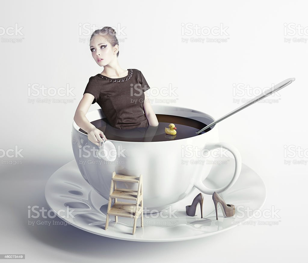 woman  in cup of coffee stock photo