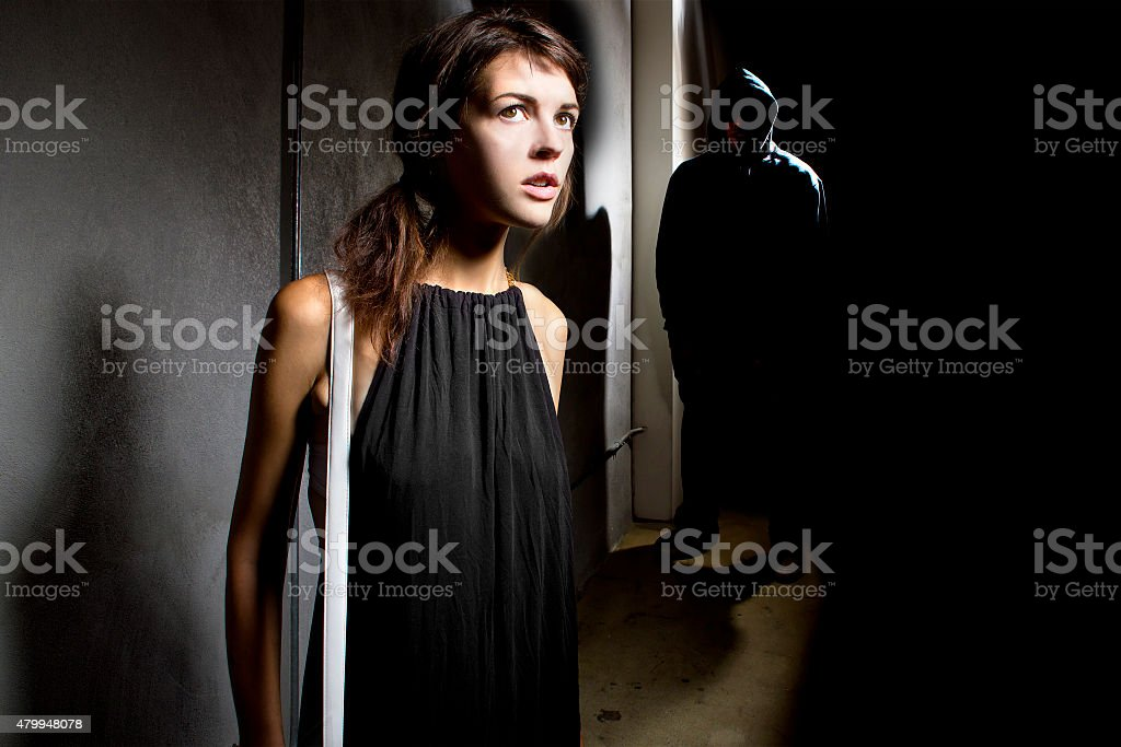 Woman In Danger at a Dark Alley stock photo
