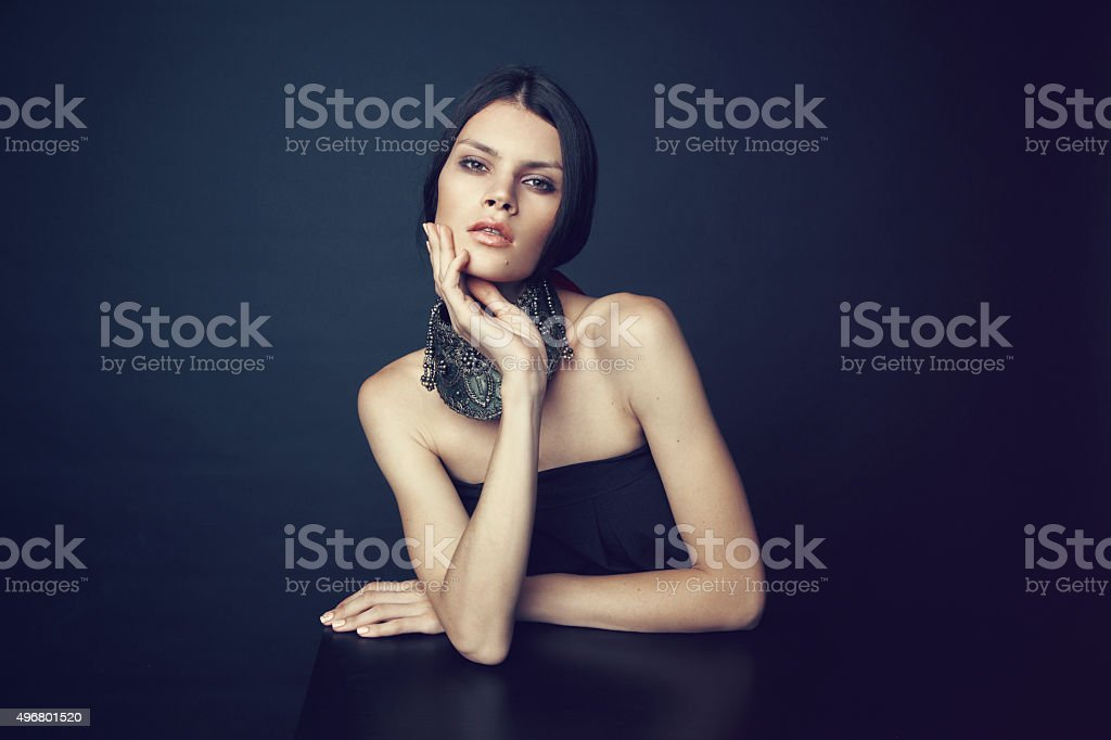 Woman in decorative silver necklace stock photo
