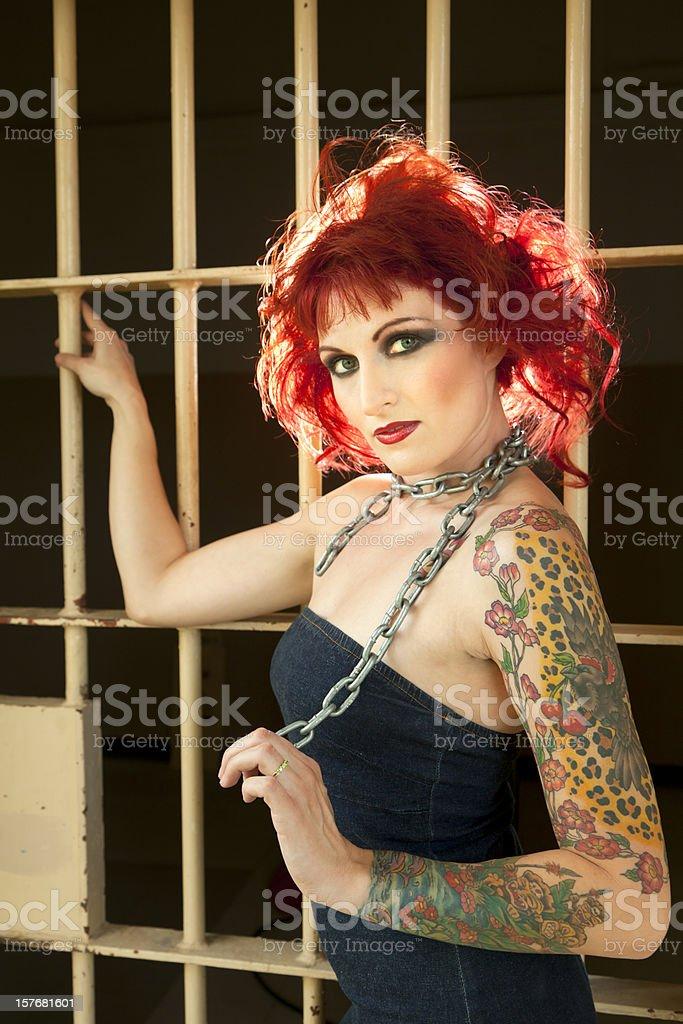 Woman in Denim Dress, Prison stock photo