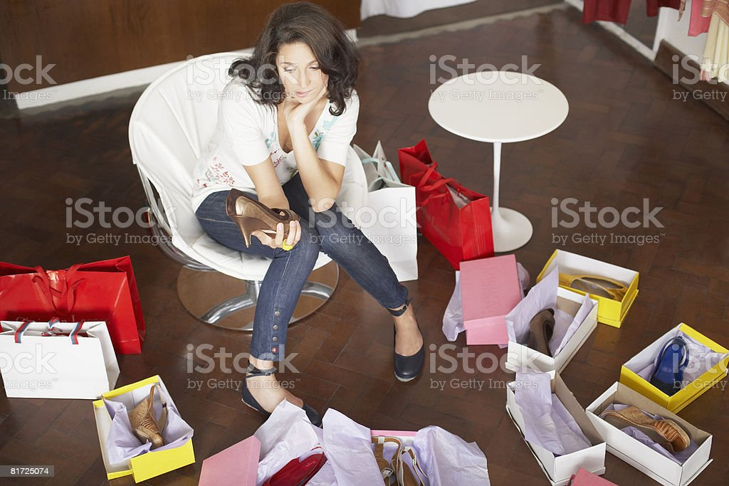 Woman in department store trying on shoes royalty-free stock photo