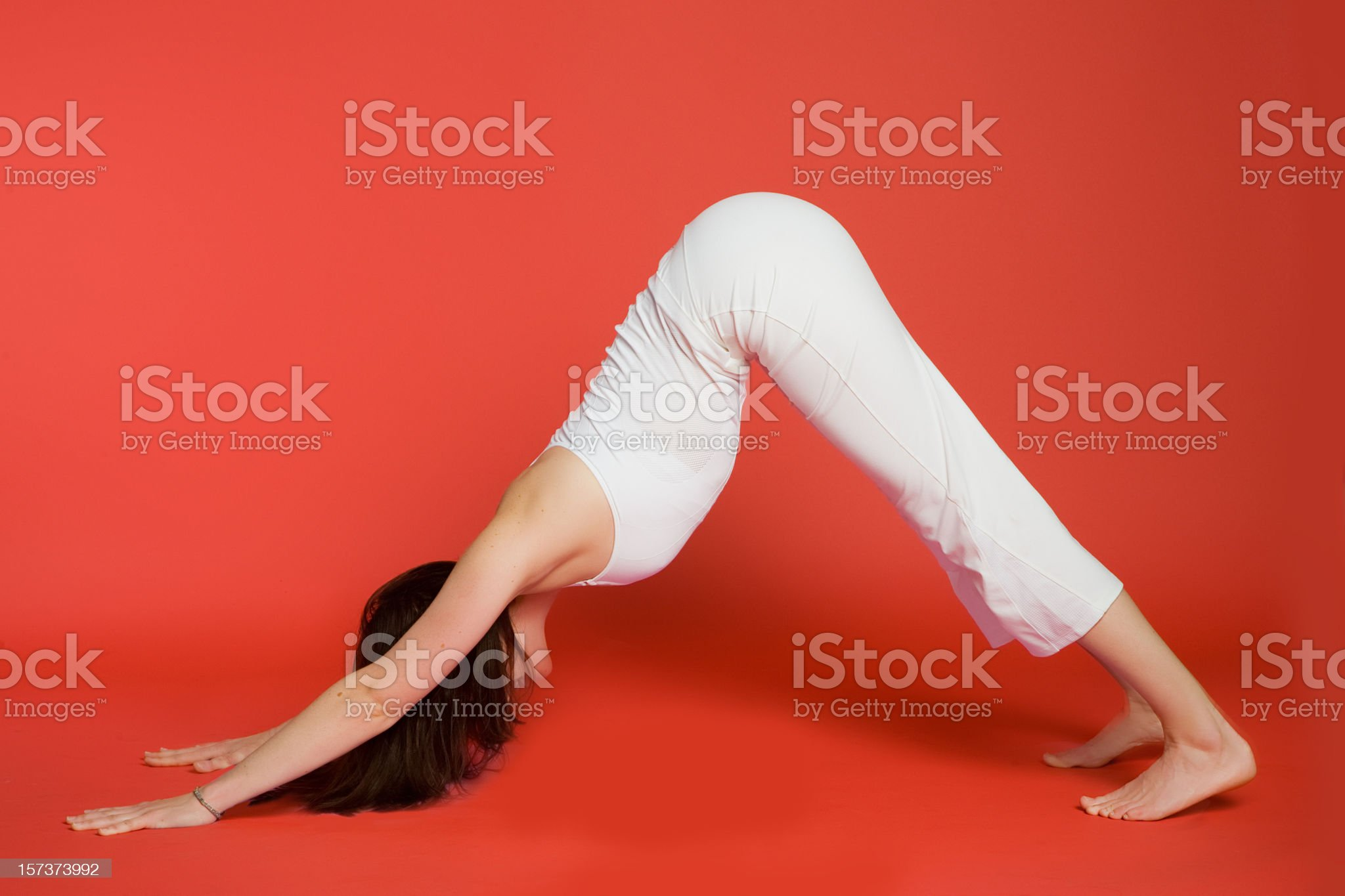 Woman in downward facing dog pose royalty-free stock photo