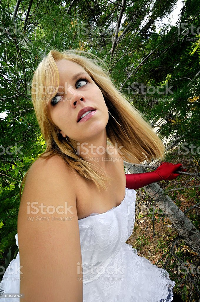 Woman in Dress Lost inthe Woods royalty-free stock photo