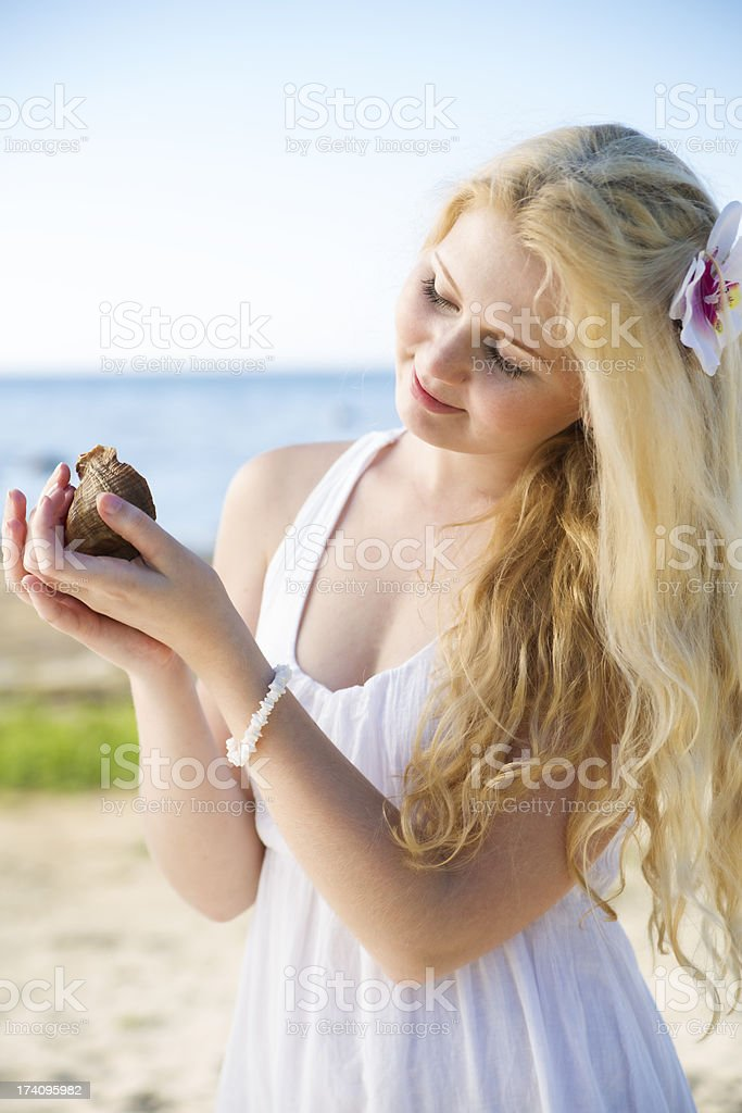 Woman in dress marvel clam at hands royalty-free stock photo