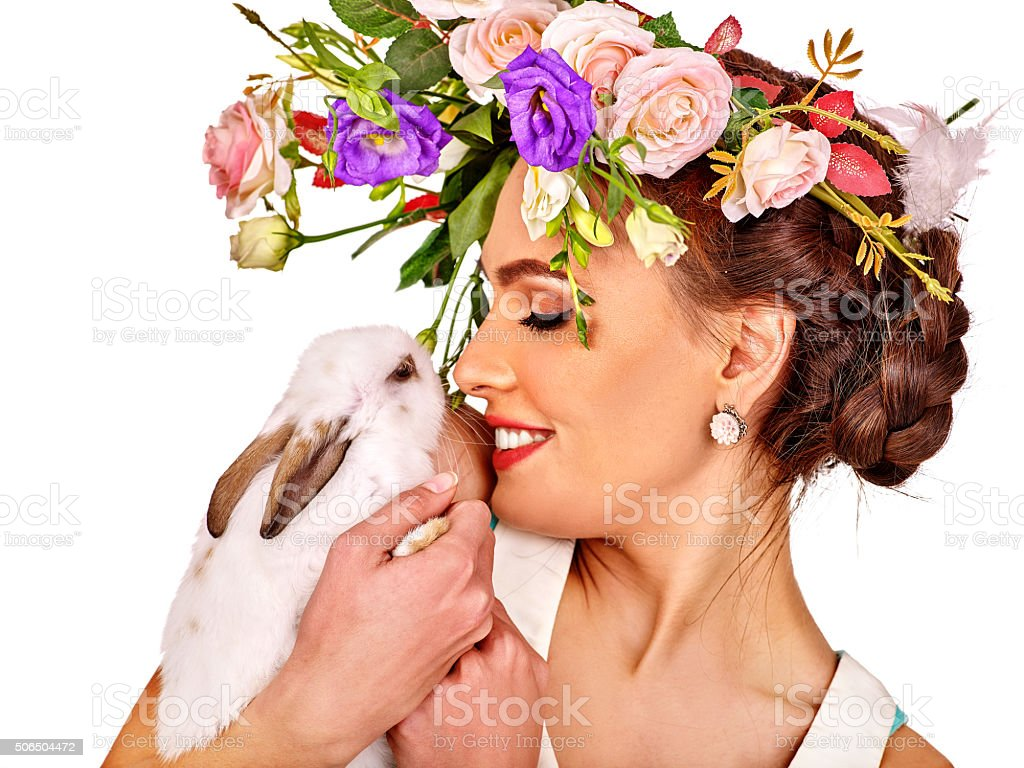 Woman in easter style holding eggs and flowers stock photo