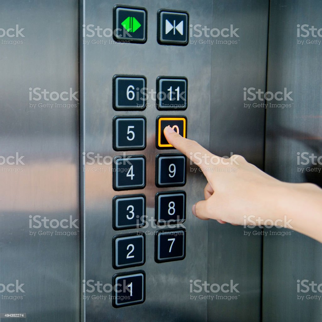 Woman in elevator stock photo