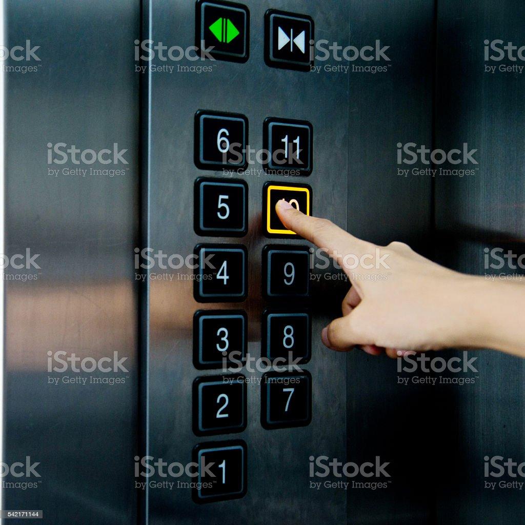 Woman in elevator stock photo