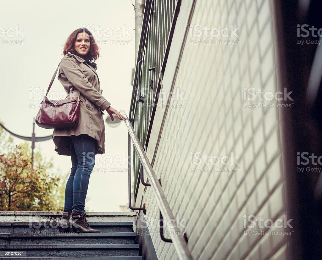 Woman in entrance to Paris Metro station. stock photo