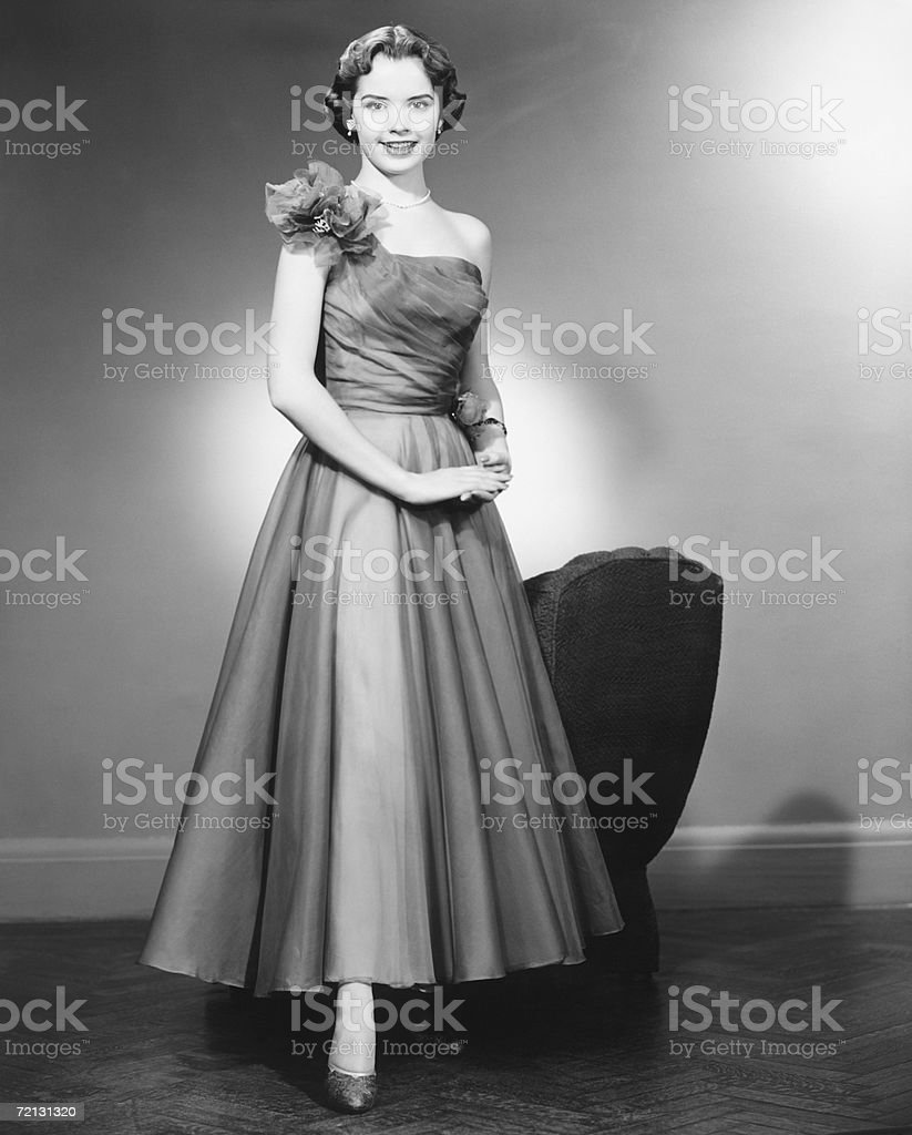 Woman in evening dress posing in studio (B&W), portrait stock photo