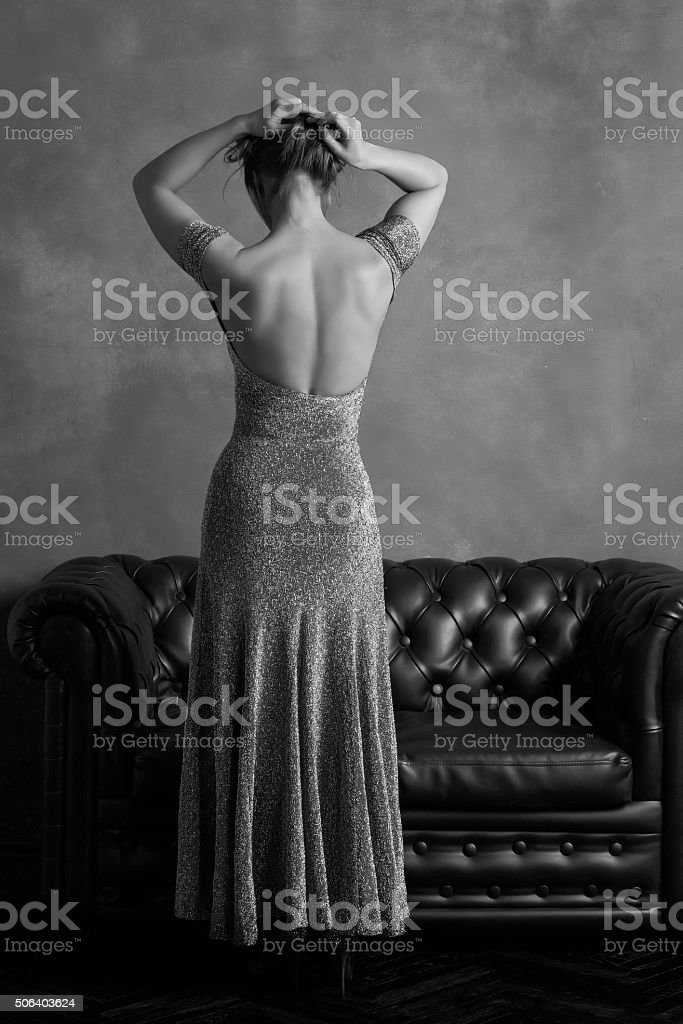 Woman in evening dress with open back stock photo
