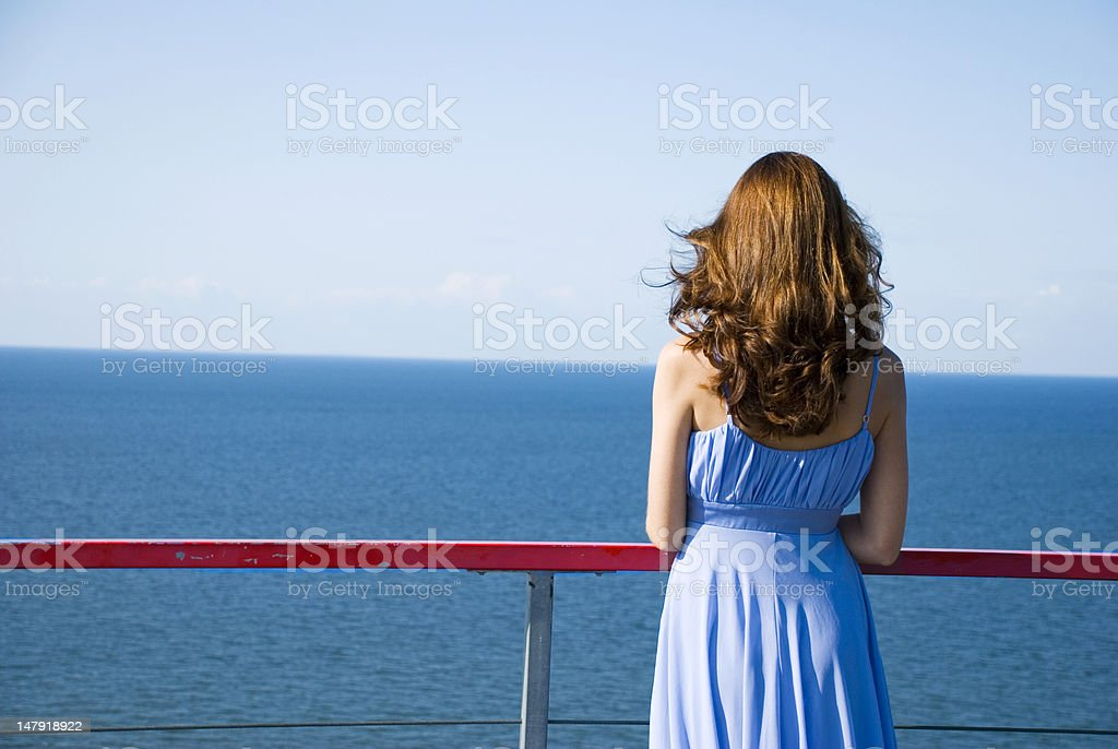 Woman in expectation looking at sea royalty-free stock photo