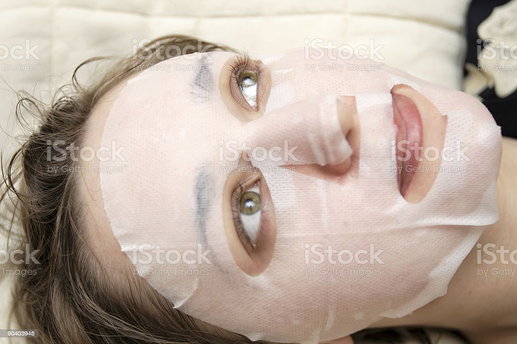 Woman in face pack stock photo
