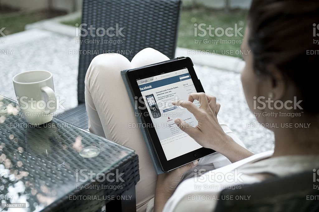 Woman in Facebook stock photo