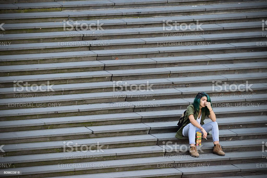 Woman in famous stairs on city square Sergels Torg, Stockholm stock photo