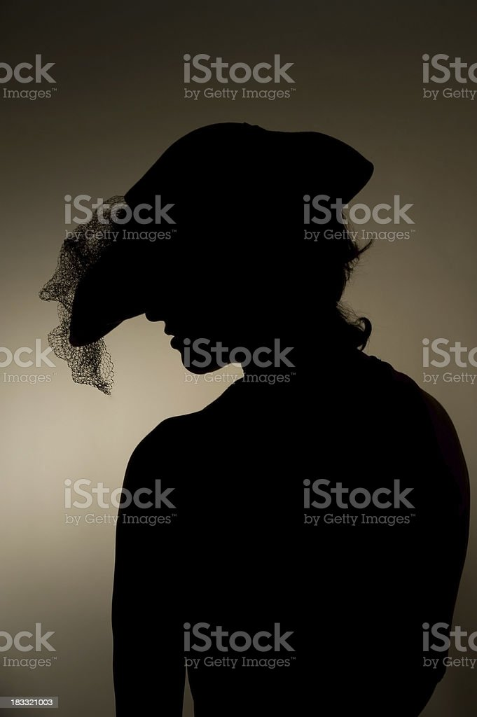 Woman in Fashionable Casablanca Hat Silhouette stock photo
