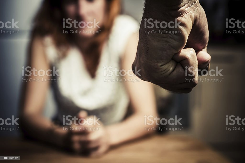 Woman in fear of domestic abuse stock photo