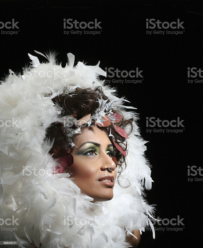 woman in feathers stock photo