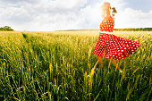 Woman in field enjoying the nature