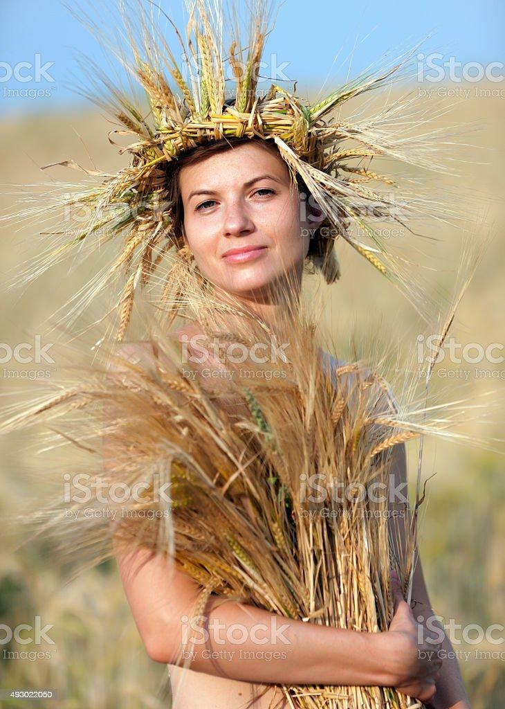 Woman in field of wheat stock photo