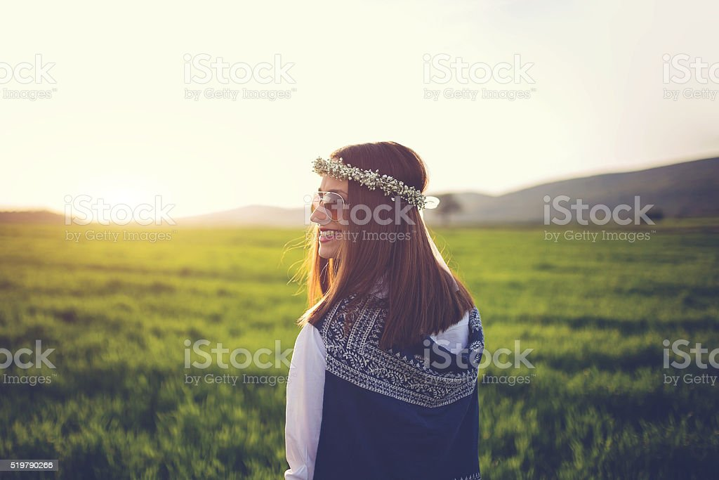 Woman in field on a beautiful spring day stock photo