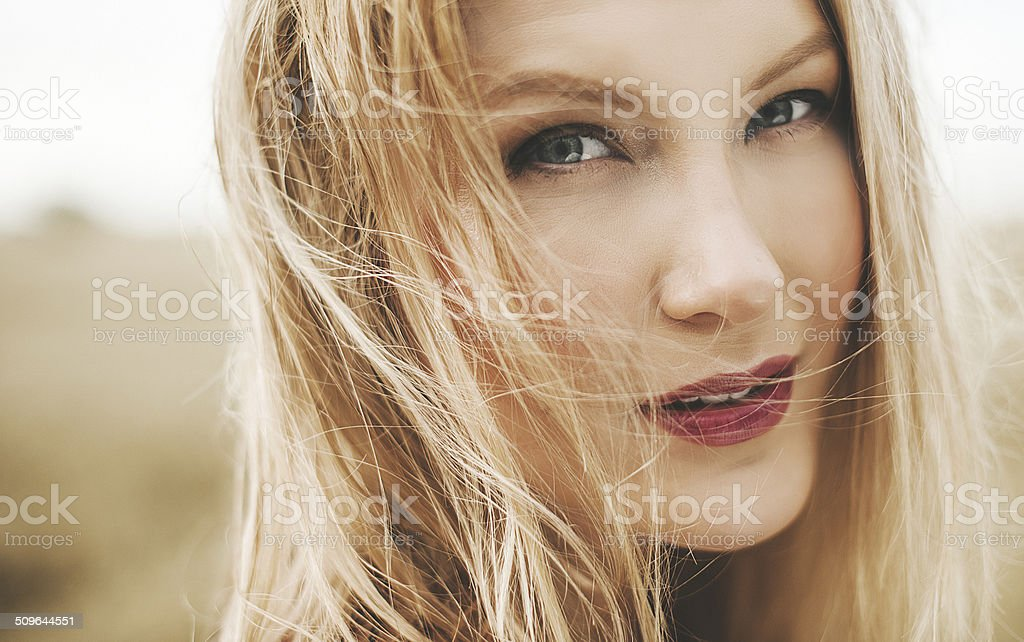 Woman in field outdoors late summer beginning of autumn stock photo