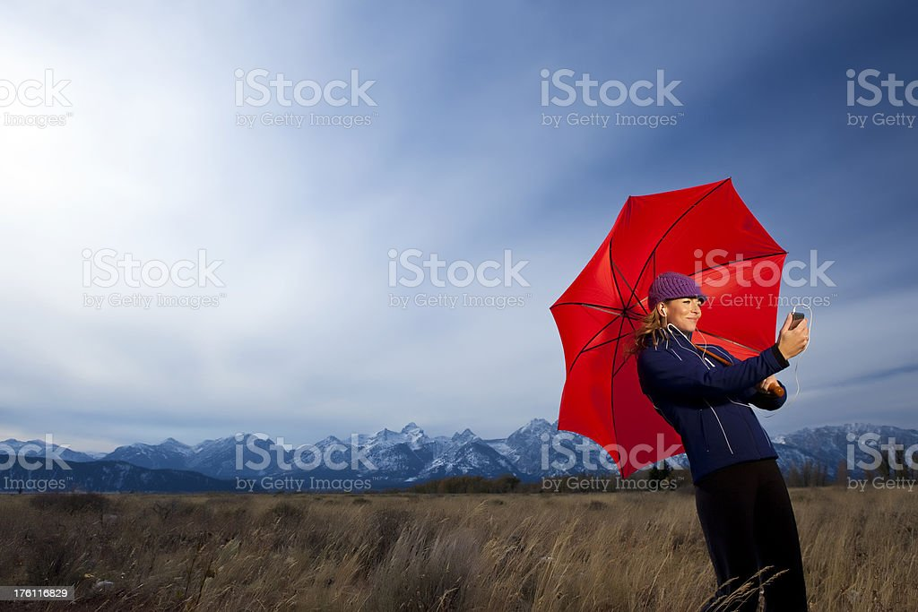 Woman in field with umbrella royalty-free stock photo