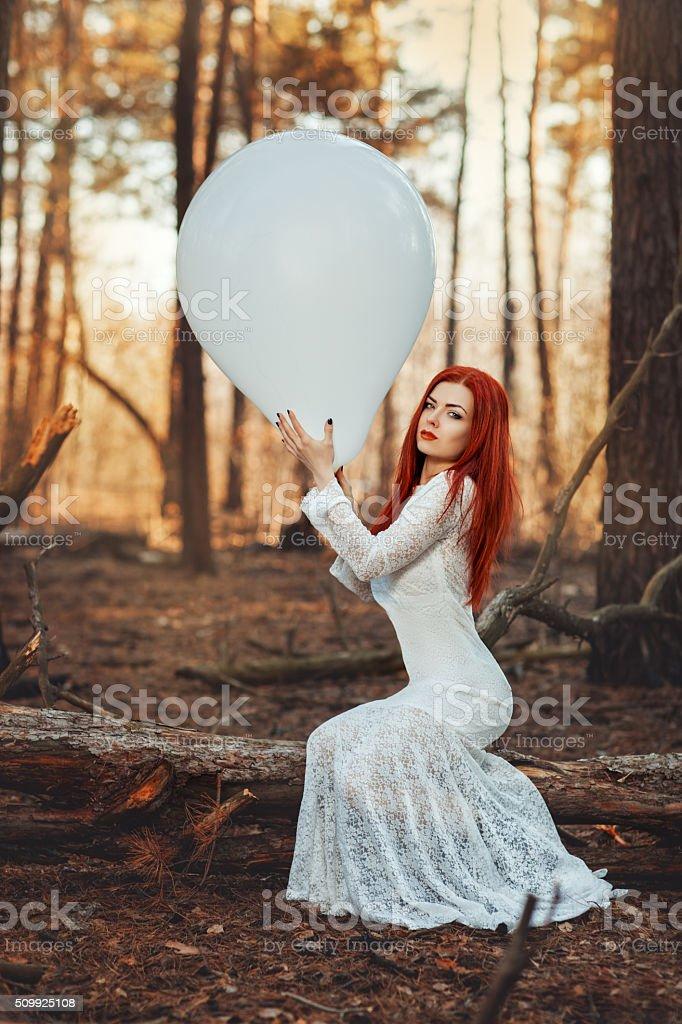 Woman in fishnet white dress. stock photo