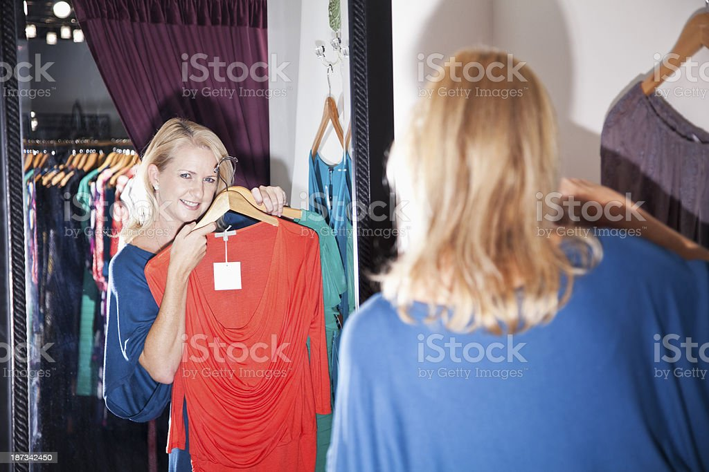 Woman in fitting room stock photo