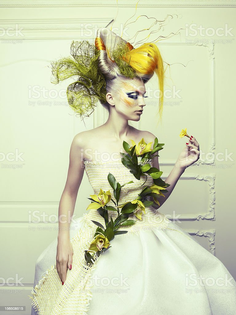 Woman in flamboyant dress with colorful, avant-garde hair royalty-free stock photo
