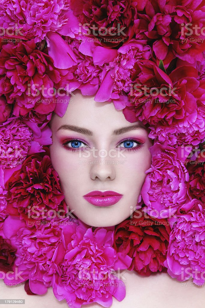 Woman in flowers royalty-free stock photo
