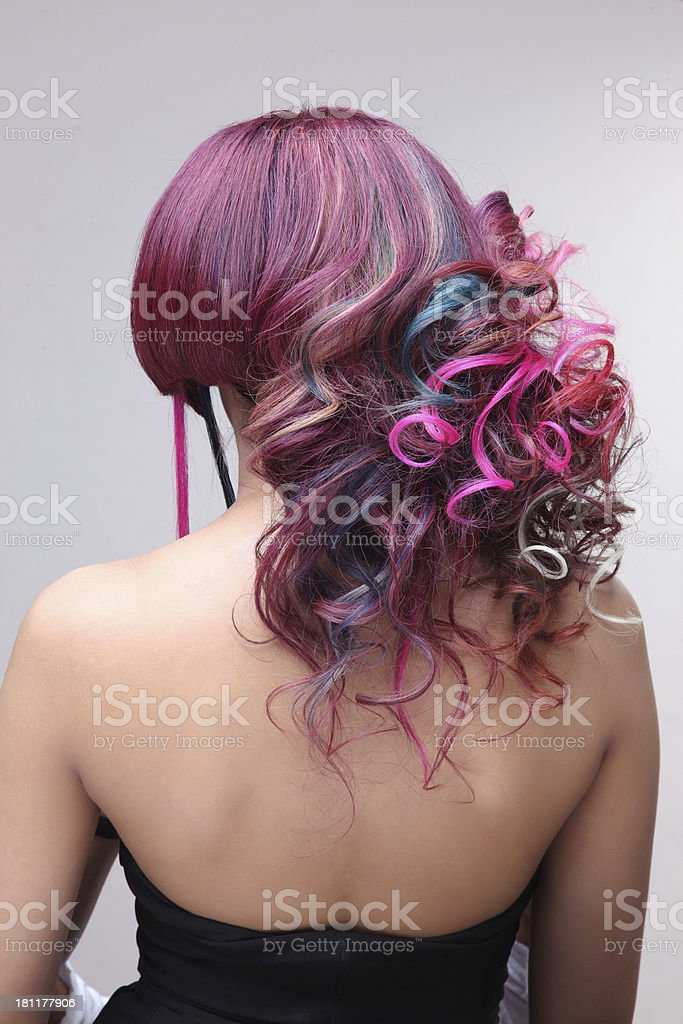 Woman in formal dress with maroon hair and highlights stock photo