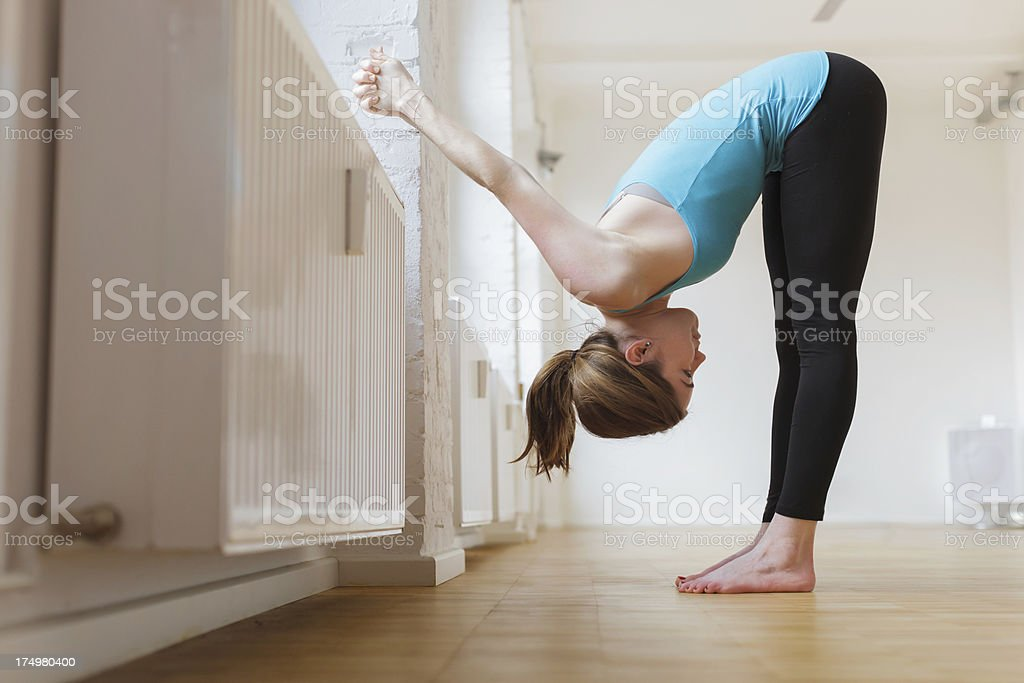 Woman in forward bending Yoga pose royalty-free stock photo