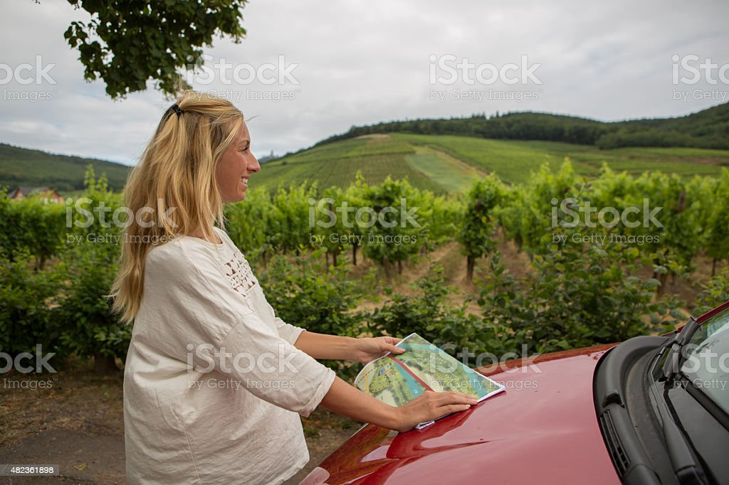 Young woman in France stops by the vineyards looking for directions...