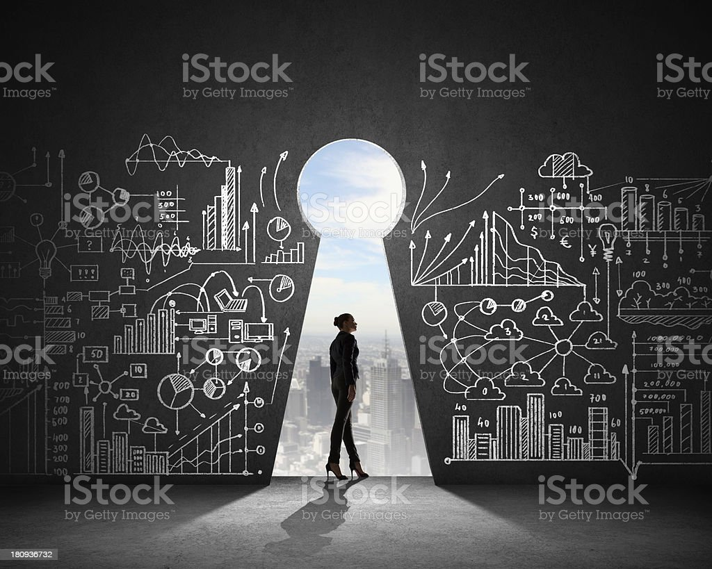 Woman in front of a wall with illustrated plans royalty-free stock photo