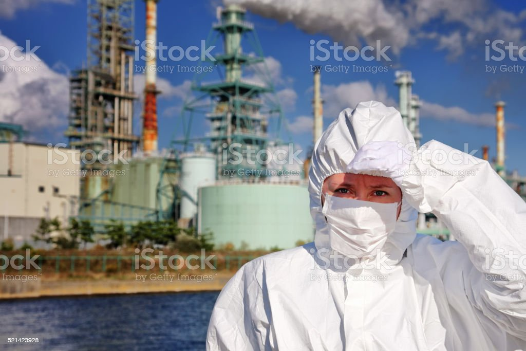 Woman in front of factory stock photo