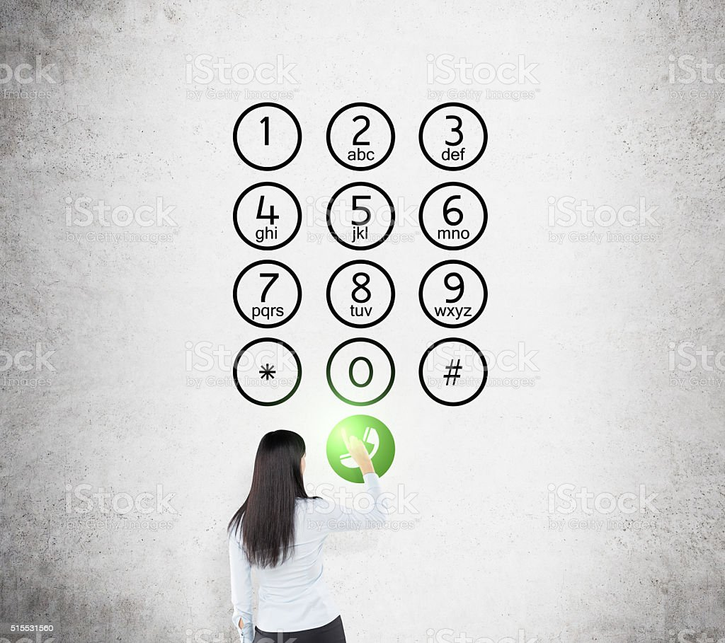 Woman in front of number buttons stock photo