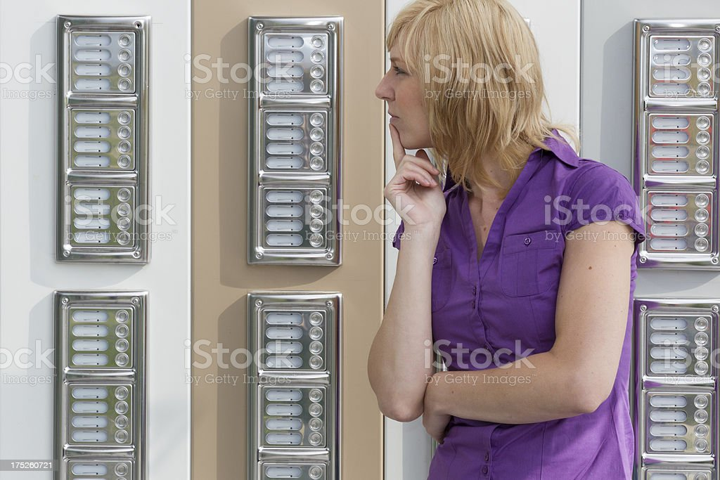 Woman in front of office, thinking royalty-free stock photo