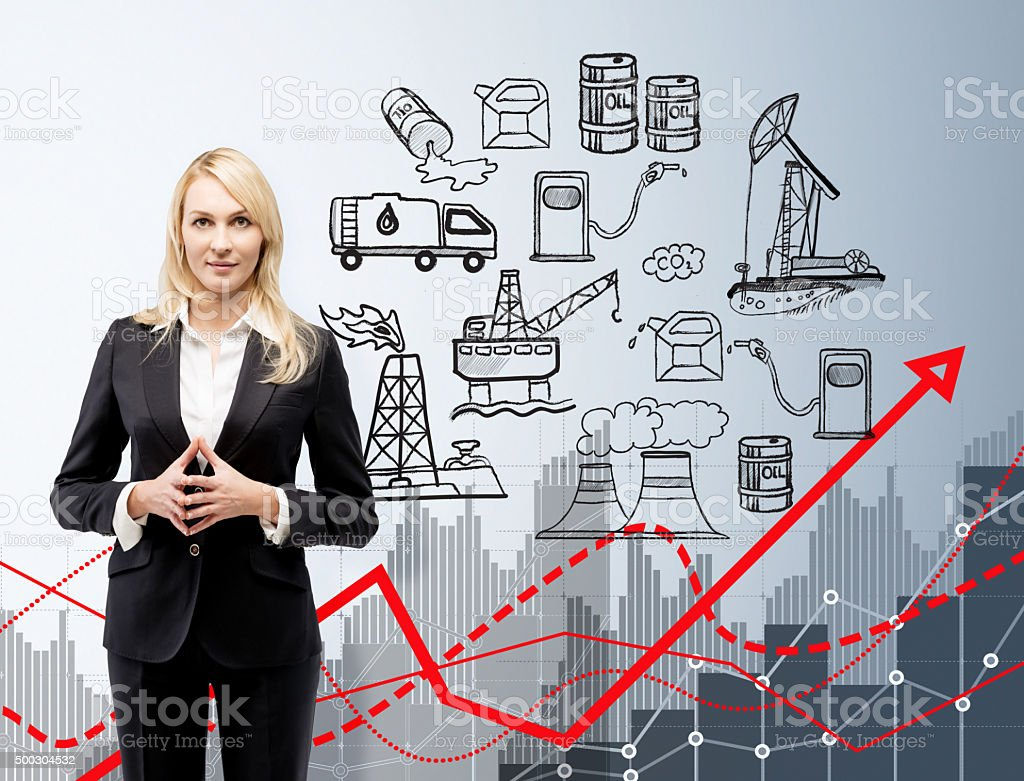 woman in front of oil production icons, oil negative effect stock photo